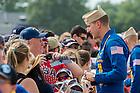 U.S. Navy Lieutenant Commander John Hlitz '02 greets spectators and signs autographs after a demonstration flight with the Blue Angels Flight Demonstration Squadron. <br /> <br /> Photo by Matt Cashore/University of Notre Dame