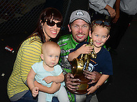 Sept. 30, 2012; Madison, IL, USA: NHRA funny car driver Jack Beckman celebrates with wife Jenna son Jason and daughter Layla after winning the Midwest Nationals at Gateway Motorsports Park. Mandatory Credit: Mark J. Rebilas-