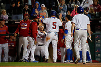 Buffalo Bisons Michael Saunders (5) high fives teammates after scoring a run during a game against the Pawtucket Red Sox on August 31, 2017 at Coca-Cola Field in Buffalo, New York.  Buffalo defeated Pawtucket 4-2.  (Mike Janes/Four Seam Images)