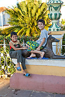 Cuba, Trinidad.  Two Boys in the Plaza Mayor.