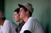 Tri-City ValleyCats starting pitcher Mark Appel #28 sits in the dugout after the first inning of his first professional start against the Lowell Spinners on July 5, 2013 at Joseph L. Bruno Stadium in Troy, New York.  Appel was the first overall selection of the 2013 Major League Baseball Draft by the Houston Astros out of Stanford University.  (Mike Janes/Four Seam Images)