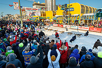 Pete Kaiser runs down 4th avenue during the Ceremonial Start of the 2017 Iditarod in Anchorage on Saturday March 4, 2017<br /> <br /> Photo by Jeff Schultz/SchultzPhoto.com  (C) 2017  ALL RIGHTS RESVERVED