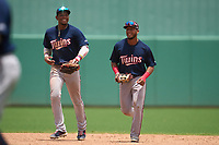 FCL Twins outfielders Carlos Aguiar (15) and Emmanuel Rodriguez (4) jog off the field after the final out of a game against the FCL Red Sox on August 7, 2021 at JetBlue Park at Fenway South in Fort Myers, Florida.  (Mike Janes/Four Seam Images)