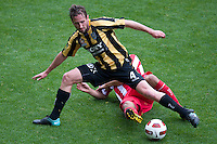 MELBOURNE, AUSTRALIA - SEPTEMBER 19, 2010: Nick Ward from the Phoenix protects the ball in Round 7 of the 2010 A-League between the Melbourne Heart and Wellington Phoenix at AAMI Park on September 19, 2010 in Melbourne, Australia. (Photo by Sydney Low / Asterisk Images)