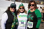 WATERTOWN,  CT-030919JS17--Laurie Rek of Watertown; Alaine Doolan of Bristol and Tina Berman of Terryville, at the 8th annual Watertown Shamrock Shuffle Road Race at Polk Elementary School in Watertown. This year, proceeds from the event will benefit the Water-Oak Circle of Sports.<br /> Jim Shannon Republican American