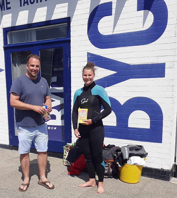 Anneka Hunter winner of the Cadet swim with Alan Whyte, Club Captain