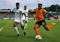Pictured: Jean Louis Akpa Akpro of Barnet (R) takes a shot past Kyle Naughton of Swansea City Wednesday 12 July 2017<br /> Re: Pre-season friendly, Barnet v Swansea City FC at The Hive, London, UK