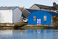 Pictured: The slipway next to the business premises (blue building) owned by the parents of Kiara Moore, where the Mini car carrying her entered river Teifi from in Cardigan, west Wales, UK. Tuesday 20 March 2018<br /> Re: The funeral of two year old Kiara Moore, who died after being recovered from a silver Mini car found in river Teifi in Cardigan will be held today (Tue 27 Mar 2018) at Parc Gwyn Crematorium, Narberth, west Wales.<br /> Kiara was taken at the University Hospital of Wales in Cardiff after being rescued but was pronounced dead.<br /> It is believed the car she was in, rolled down a slipway while her mother got out momentarily to get cash out of the family business premises.<br /> Her parents Jet Moore and Kim Rowlands have expressed their grief on social media.