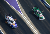 Apr. 28, 2012; Baytown, TX, USA: Aerial view of NHRA funny car driver John Force (right) races alongside Matt Hagan during qualifying for the Spring Nationals at Royal Purple Raceway. Mandatory Credit: Mark J. Rebilas-