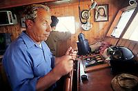 - helmsman on a fishing boat to the wide of the sicilian southern coast....- timioniere a bordo di un peschereccio al largo della costa meridionale siciliana