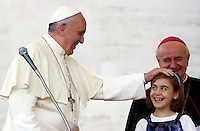 Papa Francesco accarezza una bambina al suo arrivo all'incontro con le famiglie in Piazza San Pietro, Citta' del Vaticano, 26 ottobre 2013.<br /> Pope Francis caresses a child as he arrives for a meeting with families in St. Peter's Square at the Vatican, 26 October 2013.<br /> UPDATE IMAGES PRESS/Riccardo De Luca<br /> <br /> STRICTLY ONLY FOR EDITORIAL USE