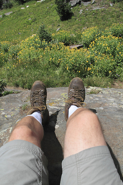 Man rests during a hike in the Indian Peaks Wilderness Area, west of Boulder, Colorado.