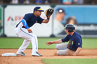 Cedar Rapids Kernels outfielder Max Murphy (13) steals second as shortstop Steven Fuentes (16) covers the bag during a game against the West Michigan Whitecaps on June 7, 2015 at Fifth Third Ballpark in Comstock Park, Michigan.  West Michigan defeated Cedar Rapids 6-2.  (Mike Janes/Four Seam Images)
