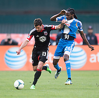 Chris Pontius (13) of D.C. United fights for the ball with Keon Daniel (26) of the Philadelphia Union during the game at the RFK Stadium in Washington DC.  Philadelphia defeated D.C. United, 3-2.