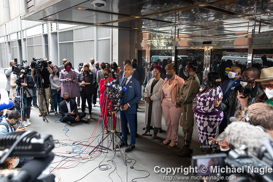 """Reverend Al Sharpton, center, speaks at a press conference in response to the George Floyd and Duante Wright cases along with Benjamin Crump, attorney for the Wright family, and members of the """"Mother's of the Movement"""" during the National Action Network (NAN) Virtual Convention 2021 in New York on Wednesday, April 14, 2021. Photograph by Michael Nagle"""