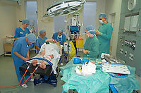 Mother giving birth in hospital operating theatre using the Caesarean section method..©shoutpictures.com.This image may only be used to portray the subject in a positive manner.john@shoutpictures.com