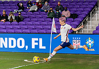 ORLANDO, FL - JANUARY 18: Megan Rapinoe #15 of the USWNT takes a corner kick during a game between Colombia and USWNT at Exploria Stadium on January 18, 2021 in Orlando, Florida.