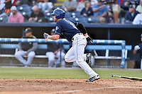 Asheville Tourists left fielder Vince Fernandez (8) runs to first base during a game against the Greenville Drive at McCormick Field on April 15, 2017 in Asheville, North Carolina. The Tourists defeated the Drive 5-4. (Tony Farlow/Four Seam Images)