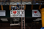 Workers lift masonry at a construction site above an gift shop in Times Square in New York on Wednesday, April 14, 2021. Photographer: Michael Nagle
