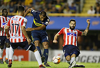 "BUENOS AIRES - ARGENTINA - 04 - 04 - 2018: Ramon Abila   (Izq.) jugador de Boca Juniors disputa el balón con Jonathan Avila (Der.) jugador de Atletico Junior, durante partido de la fase de grupos, grupo H, fecha 2, entre Boca Juniors (ARG) y Atletico Junior (Col) por la Copa Conmebol Libertadores 2018, jugado en el estadio Alberto J. Armando ""La Bombonera""  de la ciudad Ciudad Autónoma de Buenos Aires. / Ramon Abila   (L) player of Boca Juniors vies for the ball with Jonathan Avila (R) player of Atletico Junior, during a match of the groups phase, group H, of the 2nd date between Boca Juniors (ARG) and Atletico Junior (Col), for the Copa Conmebol Libertadores 2018 at the Alberto J. Armando ""La Bombonera"" Stadium in Ciudad Autónoma de Buenos Aires. Photo: VizzorImage / Javier Garcia Martino / Photogamma / Cont."
