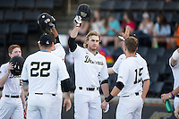 Johnny Aiello (2) of the Wake Forest Demon Deacons is congratulated by his teammates after hitting a 420-foot home run against the USC Trojans at David F. Couch Ballpark on February 24, 2017 in  Winston-Salem, North Carolina.  The Demon Deacons defeated the Trojans 15-5.  (Brian Westerholt/Four Seam Images)