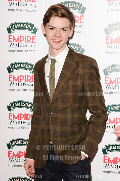 Thomas Sangster<br /> arives for the Empire Magazine Film Awards 2014 at the Grosvenor House Hotel, London. 30/03/2014 Picture by: Steve Vas / Featureflash