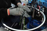 Pictured: Neal Brookfield assembling spokes with rims Monday 15 August 2016<br />Re: Frog Bikes in Mamhilad Estate Park in Pontypool, Wales, UK