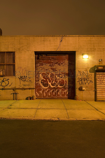 Industrial Building with Graffiti at Night in the Williamsburg neighborhood of Brooklyn, New York City, New York State, USA