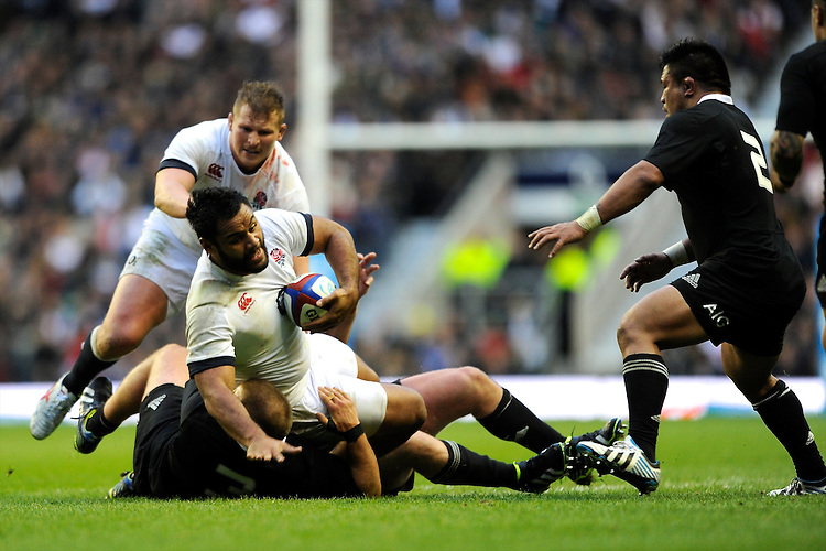 Billy Vunipola of England is tackled as Dylan Hartley of England supports during the QBE Autumn International match between England and New Zealand at Twickenham on Saturday 16th November 2013 (Photo by Rob Munro)