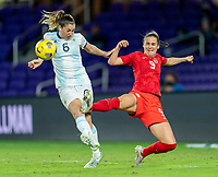 ORLANDO, FL - FEBRUARY 21: Aldana Cometti #6 of Argentina defends Evelyne Viens #9 of Canada during a game between Canada and Argentina at Exploria Stadium on February 21, 2021 in Orlando, Florida.