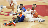 Arkansas guard Jalen Tate (right) battles for a loose ball Tuesday, Feb. 16, 2021, with Florida forward Osayi Osifo (left) during the second half of the Hogs' 75-64 win in Bud Walton Arena. Visit nwaonline.com/210217Daily/ for today's photo gallery. <br /> (NWA Democrat-Gazette/Andy Shupe)