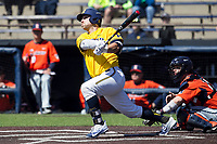 Michigan Wolverines catcher Harrison Wenson (7) follows through on his swing against the Illinois Fighting Illini during the NCAA baseball game on April 8, 2017 at Ray Fisher Stadium in Ann Arbor, Michigan. Michigan defeated Illinois 7-0. (Andrew Woolley/Four Seam Images)