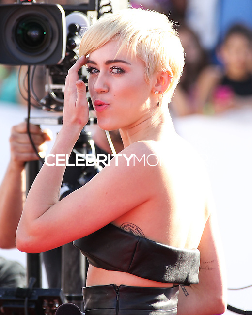 LOS ANGELES, CA, USA - AUGUST 24: Miley Cyrus at the 2014 MTV Video Music Awards held at The Forum on August 24, 2014 in the Los Angeles, California, United States. (Photo by Xavier Collin/Celebrity Monitor)