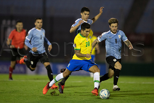 17th November 2020; Centenario Stadium, Montevideo, Uruguay; Fifa World Cup 2022 Qualifying football; Uruguay versus Brazil;  Nahitan Nández of Uruguay outpaced by Roberto Firmino of Brazil