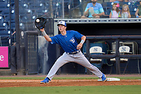 Dunedin Blue Jays first baseman PK Morris (12) stretches for a throw during a game against the Tampa Tarpons on May 7, 2021 at George M. Steinbrenner Field in Tampa, Florida.  (Mike Janes/Four Seam Images)