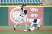 Scranton/Wilkes-Barre RailRiders second baseman Breyvic Valera (2) makes a throw to first base after getting the force out on Nick Madrigal (3) of the Charlotte Knights at BB&T BallPark on August 14, 2019 in Charlotte, North Carolina. The Knights defeated the RailRiders 13-12 in ten innings. (Brian Westerholt/Four Seam Images)