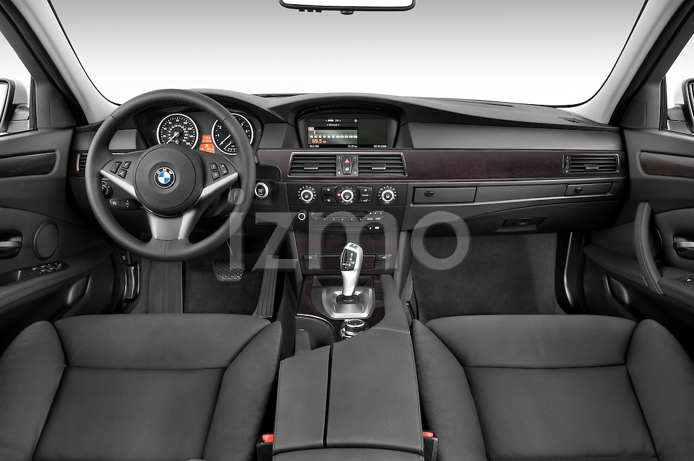 Straight dashboard view of a 2009 BMW 5 Series 528.