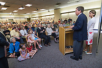 """Former Congressman and Fox News host John Kasich and wife address a gathering of fans before he signed copies of his new book, """"Stand for Something"""", in the Westerville Public Library reproduction of his Washington office. The library opened Sunday, June 11, 2006, the offices containing Kasich's historical records and personal library from his years as a U.S. congressman.<br />"""