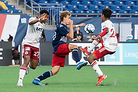 FOXBOROUGH, MA - JUNE 26: Noel Buck #61 of the New England Revolution and Rio Ramirez #24 of North Texas SC compete for a high ball during a game between North Texas SC and New England Revolution II at Gillette Stadium on June 26, 2021 in Foxborough, Massachusetts.