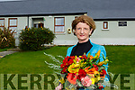 Irene O'Keeffe is presented flowers at her retirement as Principal of Coolick NS Kilcummin on Thursday