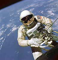 June 3, 1965 - File Photo - On June 3, 1965 Edward H. White II became the first American to step outside his spacecraft and let go, effectively setting himself adrift in the zero gravity of space. For 23 minutes White floated and maneuvered himself around the Gemini spacecraft while logging 6500 miles during his orbital stroll. White was attached to the spacecraft by a 25 foot umbilical line and a 23-ft. tether line, both wrapped in gold tape to form one cord. In his right hand White carries a Hand Held Self Maneuvering Unit (HHSMU) which is used to move about the weightless environment of space. The visor of his helmet is gold plated to protect him from the unfiltered rays of the sun.