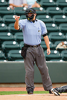 Home plate umpire Aaron Larsen makes a strike call during the Carolina League game between the Wilmington Blue Rocks and the Winston-Salem Dash at BB&T Ballpark on June 10, 2012 in Winston-Salem, North Carolina.  The Dash defeated the Blue Rocks 2-0.  (Brian Westerholt/Four Seam Images)