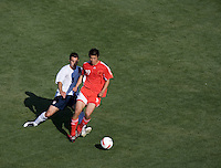 Carlos Bocanegra defends against China's Dong Fangzhuo. The USA defeated China, 4-1, in an international friendly at Spartan Stadium, San Jose, CA on June 2, 2007.