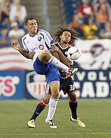 Montreal Impact substitute forward Andrew Wenger (33) passes the ball as New England Revolution defender Kevin Alston (30) pressures. In a Major League Soccer (MLS) match, Montreal Impact defeated the New England Revolution, 1-0, at Gillette Stadium on August 12, 2012.