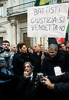 "Alberto Torregiani, al centro, figlio del gioielliere Pierluigi Torregiani, ucciso durante una rapina dai Proletari Armati per il Comunismo nel 1979, prende parte alla manifestazione di fronte all'Ambasciata del Brasile in piazza Navona, a Roma, 4 gennaio 2011, contro la decisione dell'ex presidente brasiliano Inacio Lula da Silva, nel suo ultimo giorno alla guida del paese, di non estradare l'ex terrorista Cesare Battisti in Italia. In alto, da destra, Fabrizio Cicchitto, Domenico Gramazio,.e Daniela Santanche'..Alberto Torregiani, son of  the jeweller Pierluigi Torregiani murdered by far-left armed group PAC (Proletari Armati per il Comunismo) on 1979, takes part in a demonstration in front of Brazil's Embassy in Navona square, Rome, 4 january 2011, against former Brazilian President Inacio Lula da Silva's decision, on his last day in office, not to extradite the Italian former left-wing rebel Cesare Battisti to Italy. At top, second from right, is senator Domenico Gramazio, holding a banner reading ""Battisti, justice, not revenge"", flanked by lawmaker Fabrizio Cicchitto, right, and government undersecretary Daniela Santanche'..Alberto Torregiani was shot in the back and remains paralyzed from the shootout in which his father was killed..UPDATE IMAGES PRESS/Riccardo De Luca"