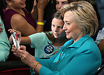 Democratic presidential nominee Hillary Clinton takes a selfie with supporter Jessica Rivera, 10, during a campaign stop at Truckee Meadows Community College in Reno, Nev., on Thursday, Aug. 25, 2016. Cathleen Allison/Las Vegas Review-Journal
