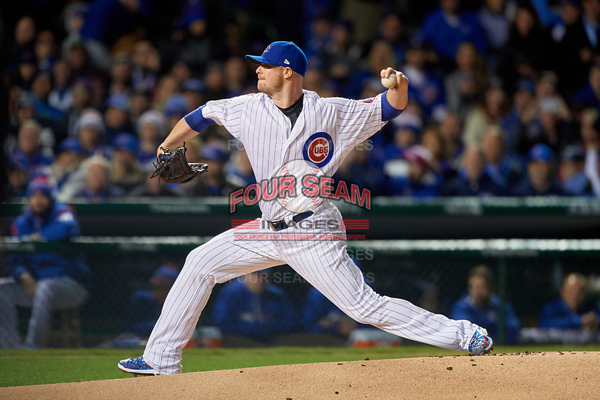 Chicago Cubs pitcher Jon Lester (34) delivers a pitch in the first inning during Game 5 of the Major League Baseball World Series against the Cleveland Indians on October 30, 2016 at Wrigley Field in Chicago, Illinois.  (Mike Janes/Four Seam Images)