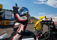 Jul 21, 2019; Morrison, CO, USA; NHRA top fuel driver Steve Torrence celebrates after winning the Mile High Nationals at Bandimere Speedway. Mandatory Credit: Mark J. Rebilas-USA TODAY Sports