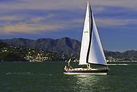 San Francisco, California - Sailing on San Francisco Bay.  Sausalito, Marin County in Background.