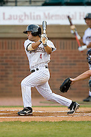 Jose Altuve #4 of the Greeneville Astros follows through on his swing versus the Danville Braves at Pioneer Park June 28, 2009 in Greeneville, Tennessee. (Photo by Brian Westerholt / Four Seam Images)
